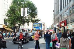 Remittance advertising in Oxford Street, London with Polish and Russian slogans. Credit: Kaihsu Tai | Wikimedia Commons