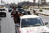 Fighting was still going on in many parts of the city August 27 between the rebels and Gaddafi's loyalists.