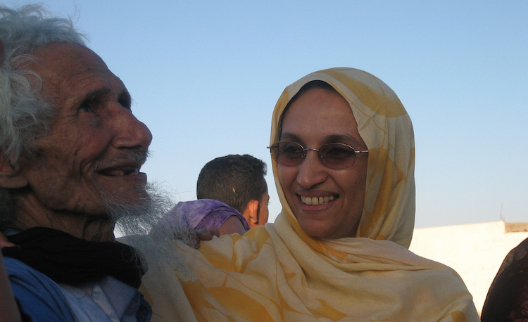 Photo: Aminatou Haidar meeting an old friend on her departure from prison. CC BY-SA 2.0