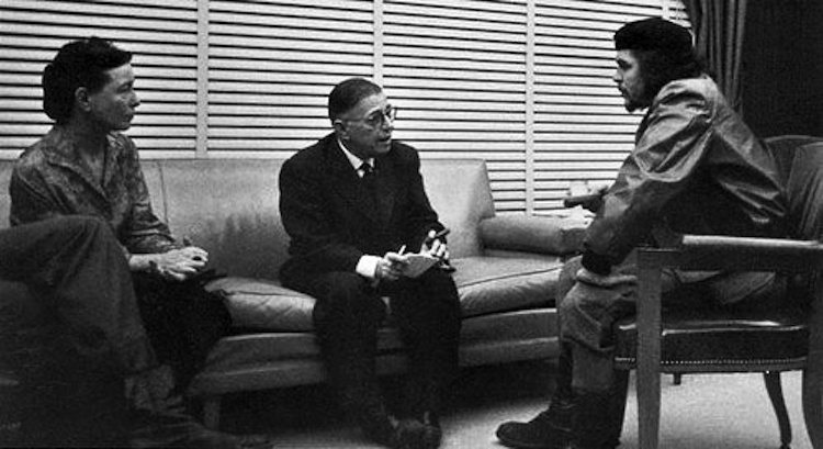 "Photo: Guevara meeting with French existentialist philosophers Jean-Paul Sartre and Simone de Beauvoir at his office in Havana, March 1960. Sartre later wrote that Che was ""the most complete human being of our time"". In addition to Spanish, Guevara was fluent in French. Credit: Wikimedia Commons."