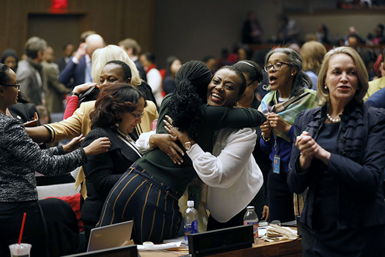 Photo: Participants at the 62nd session of the UN Commission on the Status of Women rejoice as the Commission adopts Agreed Conclusions to ensure the rights and development of rural women and girls. Credit: UN Women/Ryan Brown.