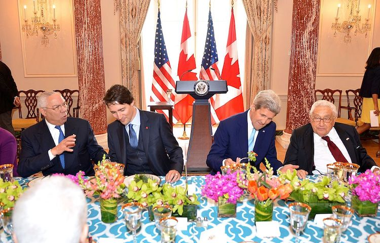 Photo: From left to right, former U.S. Secretary of State Colin Powell, Canadian Prime Minister Justin Trudeau, U.S. Secretary of State John Kerry, and former U.S. Secretary of State Henry Kissinger chat at the State Luncheon in honour of the Prime Minister at the U.S. Department of State in Washington, D.C., on March 10, 2016. [State Department photo/ Public Domain]