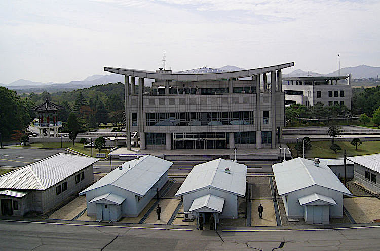 Photo: The Joint Security Area (JSA) in the DMZ, looking toward South Korea from the North. Conference Row seen from the northern side of the JSA. CC BY-SA 3.0