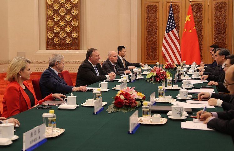 Photo: Acting Under Secretary of State for Public Diplomacy and Public Affairs, Heather Nauert (first on the left) and U.S. Secretary of State Mike Pompeo (centre) meeting with Chinese State Councilor Wang Yi in Beijing, China on June 14, 2018. Credit: Wikimedia Commons.