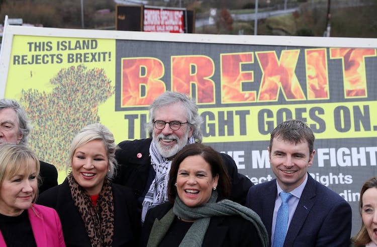 Photo: Sinn Féin leader Mary Lou McDonald (centre) with former leader Gerry Adams on the Irish border. Credit: Brian Lawless/PA Wire