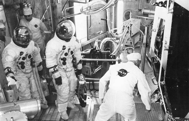 Photo: Apollo 11 backup crew members Fred Haise (left) and Jim Lovell prepare to enter the Lunar Module for an altitude test. Credit: NASA.