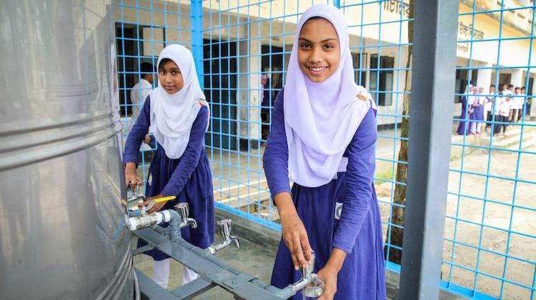 Photo: An arsenic-free water plant has been established in Sirajganj, Bangladesh, enabling students to access arsenic-free water. Previously, they had to rely on pond water, making them susceptible to disease. 5 May 2016. ©GMB Akashss
