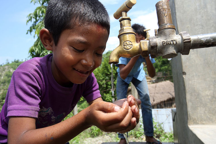 Photo: Boy drinks from a tap at a NEWAH WASH water project in Puware Shikhar, Udayapur District, Nepal. Photo by Jim Holmes for AusAID. Source: Wikimedia Commons