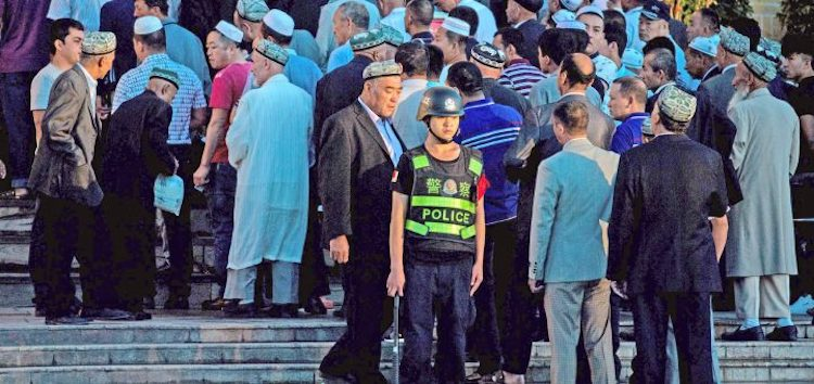 Photo: Hanization raising  discontent among Uyghur Muslims in Xinjiang. Credit: The Kootneeti.