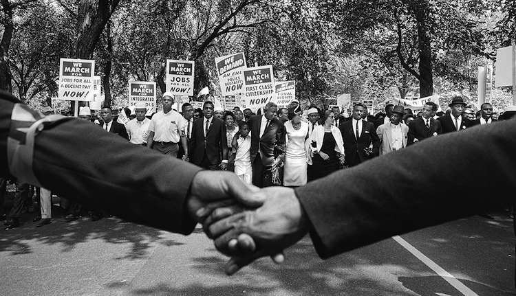 Photo: View of the front line of demonstrators during the March on Washington in 1963 over clasped hands. Credit: Steve Schapiro/Corbis. Source: AARP