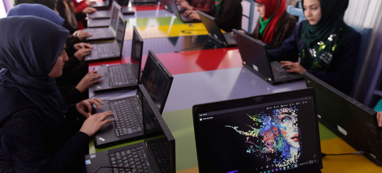 Photo: UNAMA/Fraidoon Poya. Women learning to code at a technology centre in Herat, western Afghanistan.