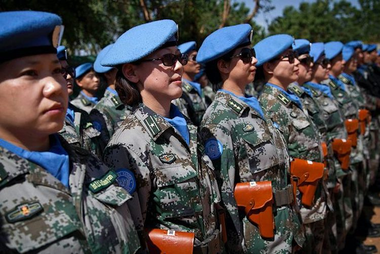 Chinese peacekeepers marking International Women's Day in Gao, a base in the UN mission in Mali. China, a permanent member of the UN Security Council, has presented a policy paper on UN reform that suggests a leap forward on the world stage as the US, by contrast, recedes. MARCO DORMINO/MINUSMA