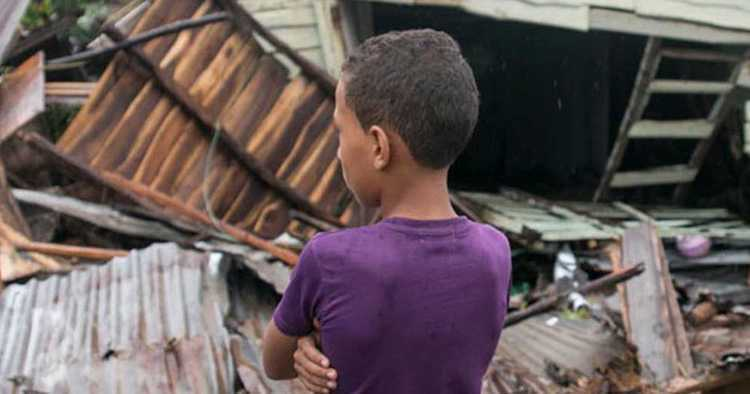 Photo: Boy stands in front of debris as hurricane Irma moves off from the northern coast of the Dominican Republic. Credit: UNICEF