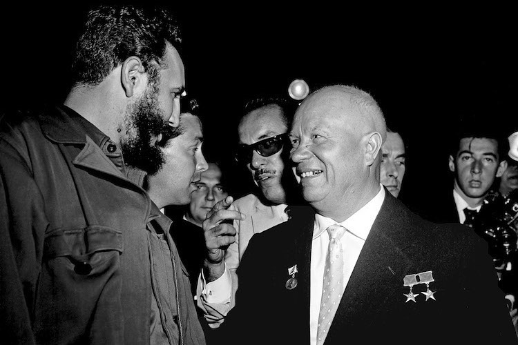 Photo: In the Assembly Hall shortly before the meeting got under way, Premier N.S. Khrushchev (right), Chairman of the Council of Ministers of the USSR, and Premier Fidel Castro, of Cuba, are seen greeting each other. UN Photo. 20 September 1960. United Nations, New York.