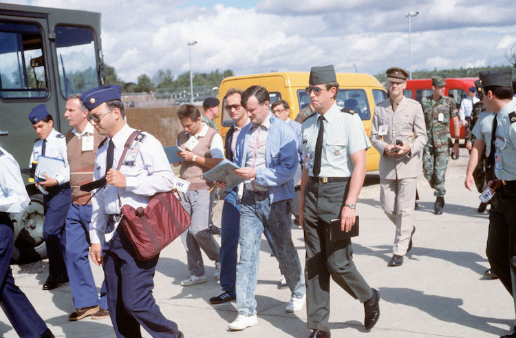 Photo: Accompanied by their NATO counterparts, the then Soviet inspectors enter a weapons storage area to verify NATO compliance with the INF Treaty. Created on 16 August 1989. Source: Wikimedia Commons