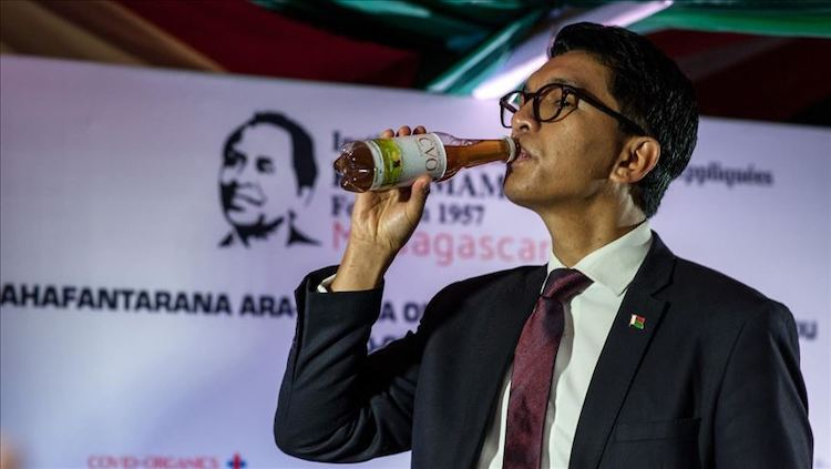 Photo: The Madagascar president drinking COVID Organics (CVO), an organic herbal beverage, he claims could pre vent or cure the virus.