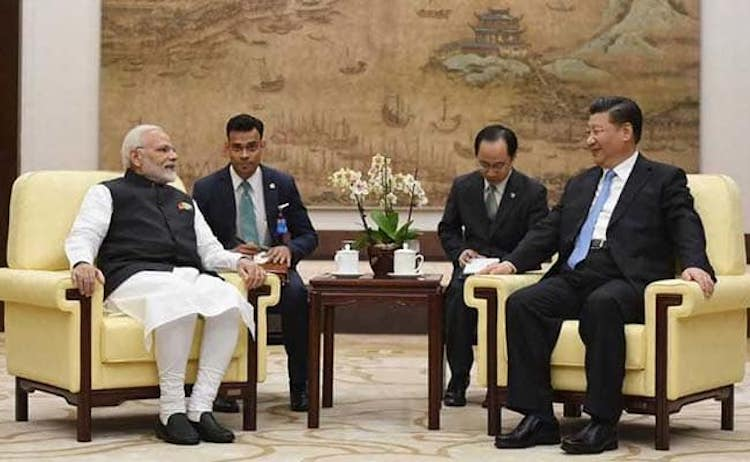 Photo: The first Xi–Modi meeting of 2018 at Wuhan, China in April was a rare one-on-one informal summit. Source: NDTV