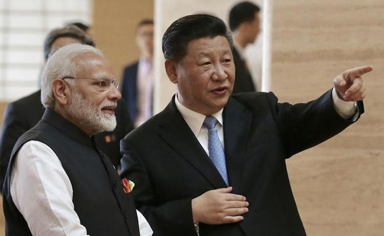 Photo: Chinese President Xi Jinping (right) talks with Indian Prime Minister Narendra Modi at Hubei Provincial Museum in Wuhan city, Central China's Hubei province, April 27, 2018. Credit: XU JINGXING / chinadaily.com.cn