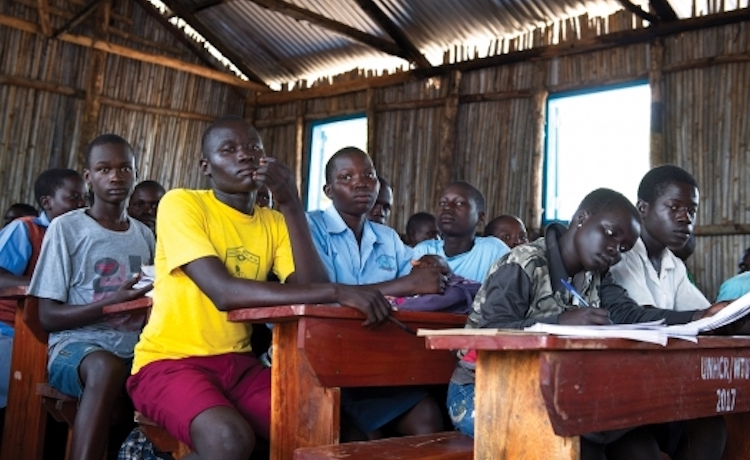Photo: Refugee students in a classroom in Uganda. UN Photo/Mark Garten