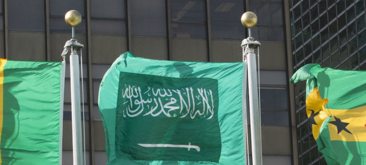 Image: The flag of Saudi Arabia (centre) flying at United Nations headquarters in New York. UN Photo/Loey Felipe