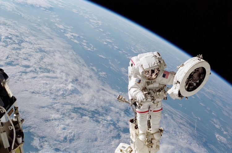 Image: In this image from June 2002, astronaut Franklin R. Chang-Diaz works with a grapple fixture during a spacewalk on the STS-111 mission to perform work on the International Space Station. Credit: NASA.