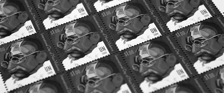 Photo: Commemorative stamp for the International Day of Non-Violence featuring Mahatma Gandhi by artist Ferdie Pacheco. UN Photo/Ryan Brown.