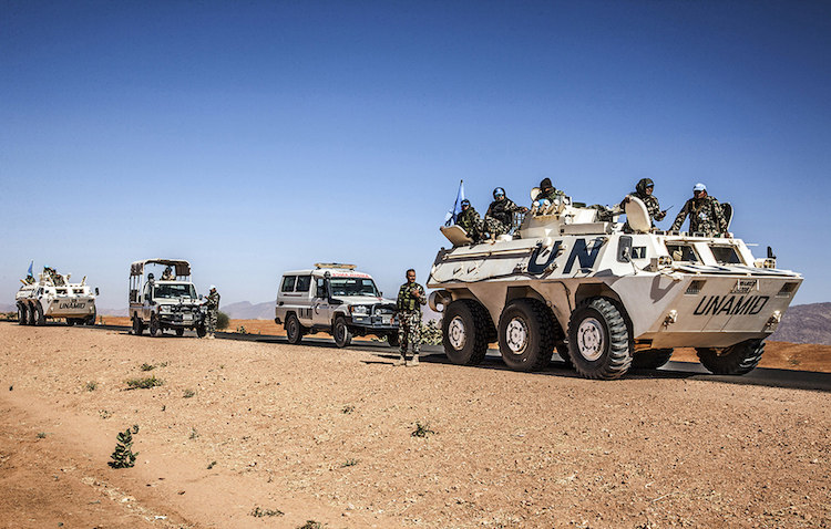 Photo: Escorted team from UNAMID's Governance and Community Stabilization Section is pictured on its way to Birka area, North Darfur. The purpose of the trip, which took place on 2 February 2018, was to conduct a peace conference for farmers and herders as part of the Mission's support to peaceful coexistence and stability between the two communities. Credit: Mohamad Almahady, UNAMID.