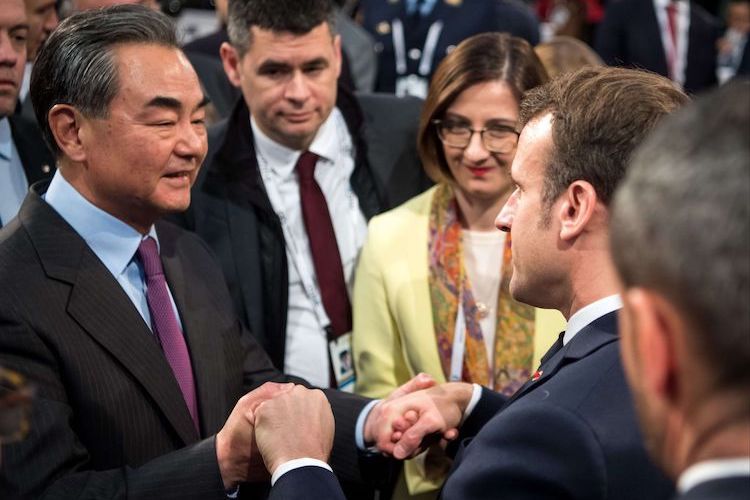 Photo: Wang YI, State Councillor and Minister of Foreign Affairs of China (left) with French President Macron (right) at the MSC 2020. Source: MSC/Hennemuth
