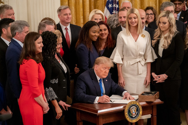 Photo: President Trump signs an Executive Order at the White House Summit on Human Trafficking in honour of the 20th Anniversary of the Trafficking Victims Protection Act of 2000, Jan. 31, 2020. Official White House Photo by Andrea Hanks.
