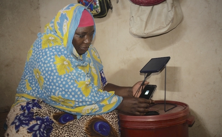 2019] Photo: Mariam Kassim Salum charging her phone on a solar equipment at Kizimkazi village in Zanzibar, Tanzania. Courtesy: Barefoot College